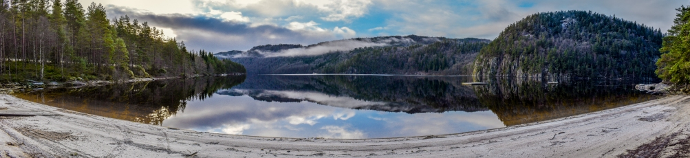 I wanted one photo that captured all the reflections and the small beach at the lake Ytre Øydnavatnet in the south of Norway. I took a series of photos and merged them together to a very detailed panorama image.