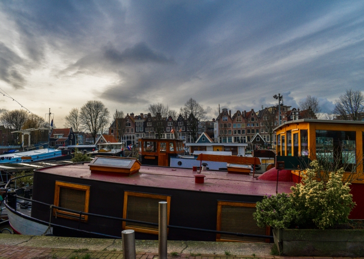 Light reflecting on a houseboat at Westerdok in Amsterdam