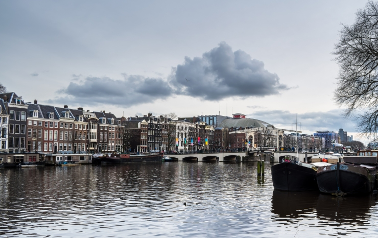 View of the Magere Brug and the old townhouses along the Amstel Canal in Amsterdam.