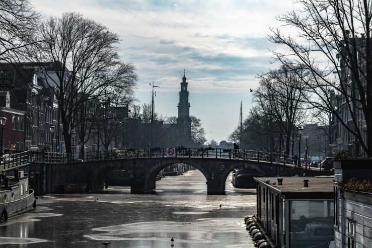 Frozen canal in Amsterdam. I used a polarizer filter for this photo.